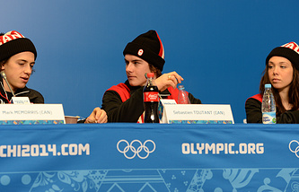Canadian Olympic snowboarders Mark McMorris (L) Sebastien Toutant (C) and Jenna Blasman (R)