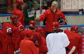 Head coach Zinetula Bilyaletdinov (R background) instructs his players during a training session