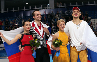 Gold medalists Tatiana Volosozhar and Maxim Trankov of Russia (R) and silver medalists Ksenia Stolbova and Fedor Klimov of Russia (L