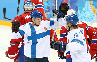 Lauri Korpikoski (L) of Finland celebrates after scoring over Norway