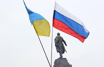 Ukrainian and Russian flags seen in Kharkiv