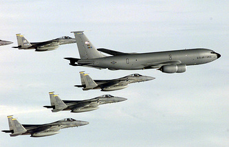 KC-135R Stratotanker provides enroute refueling support to six F-15C Eagles (archive)