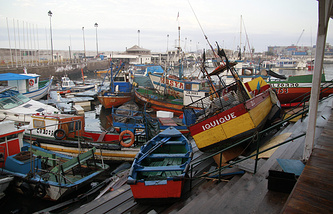 Boats washed up the harbor installations in Chile after the earthquake