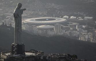 Maracana stadium behind the Christ the Redeemer statue in Rio de Janeiro, Brazil
