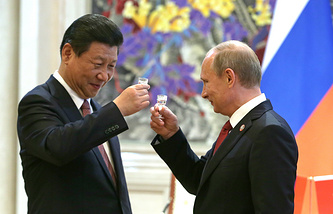 China's president Xi Jinping (L) and Russia's president Vladimir Putin seen after signing joint documents