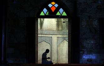 A man prays in a mosque