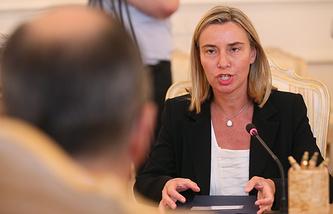 talian Foreign Minister Federica Mogherini (right)
