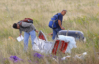 Experts examine the crash site