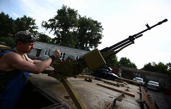 A militia fighter in Ukraine's Luhansk Region