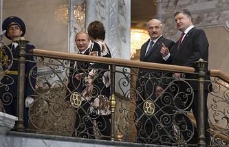 Russian President Vladimir Putin, left, EU foreign policy chief Catherine Ashton, Belarusian President Alexander Lukashenko and Ukrainian President Petro Poroshenko
