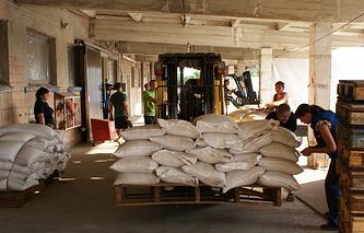 Russian humanitarian aid unloaded in Ukraine's Luhansk Region