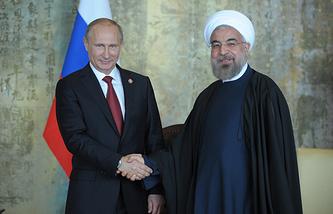 Russian President Vladimir Putin (L) and Iranian President Hassan Rouhani (R)