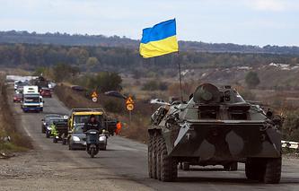 A Ukrainian Armored Personnel Carrier (APC) drives on a road near Slaviansk, Ukraine, October 5, 2014