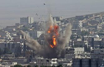 Smoke rise after US-led coalition airstrike on Kobane, Syria