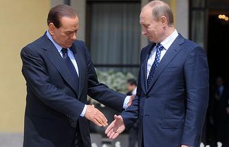 Russian President Vladimir Putin with Ita;y's then Prime Minister Silvio Berlusconi
