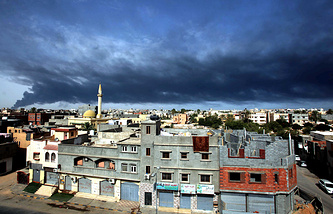 Smoke over Tripoli after militia rockets hit a fuel tank
