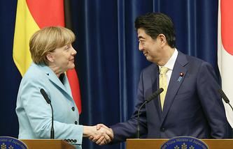 Germany's Chancellor Angela Merkel and Japanese Prime Minister Shinzo Abe