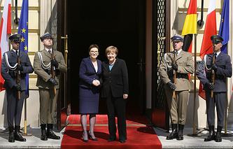 Polish Prime Minister Ewa Kopacz and German Chancellor Angela Merkel