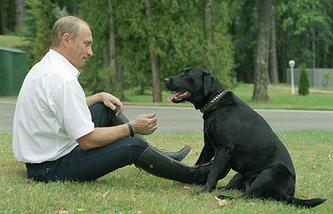 Vladimir Putin with his Labrador, 2003
