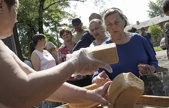 Volunteers distributing bread for local citizens in Donetsk