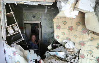 A woman in a shattered building, Donetsk