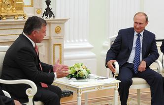 Russian President Vladimir Putin and  Jordan's King Abdullah II