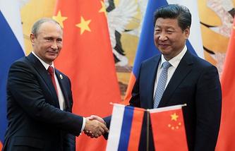 Russian President Vladimir Putin and China's President Xi Jinping (archive)