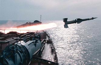 Russian navy cruiser firing a missile