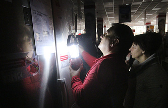 Local residents in a household appliances store during a blackout in Crimea