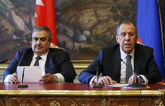 Bahrain's Foreign Minister Khalid bin Ahmed Al Khalifa and Russian Foreign Miniter Sergei Lavrov