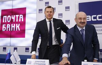 General Director of the Russian Post Dmitry Strashnov and VTB 24 President Mikhail Zadornov