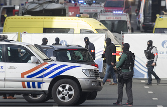Emergency workers and police at Rue de la Loi, after an explosion at Maelbeek Metro station, Brussels