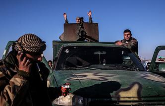 Syrian servicemen in Aleppo