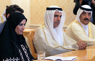 President of the UAE Federal National Council Amal Al Qubaisi (left)