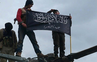 Rebels from Jabhat al-Nusra waving their flag
