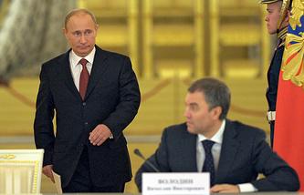 Vladimir Putin and Vyacheslav Volodin (sitting)
