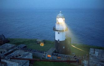A lighthouse on the Krai Sveta Cape (edge of the world) on Shikotan Island
