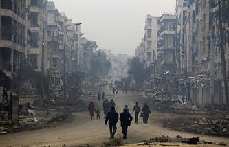 Residents in Salaheddine neighborhood in the eastern Aleppo, Syria