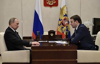 Vladimir Putin and Maxim Oreshkin