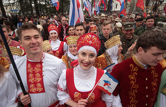 People in traditional Russian costume during a celebration marking the 3rd anniversary of the 2014 referendum on the political status of Crimea