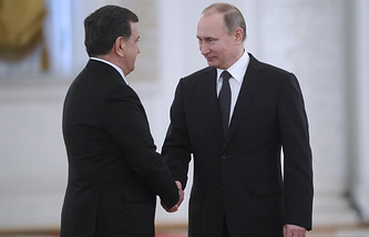 Uzbek President Shavkat Mirziyoyev and Russian President Vladimir Putin