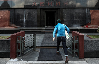 A man visits the Lenin Mausoleum in Red Square