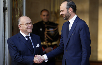 Outgoing French Prime Minister Bernard Cazeneuve and newly appointed French Prime Minister Edouard Philippe