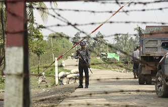 A Myanmar police officer in Shwe Zar villag, northern Rakhine state of Myanmar