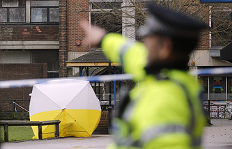 A police tent covers the area where Sergei Skripal and his daughter were found in Salisbury