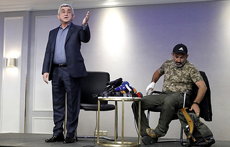 Armenian Prime Minister Serzh Sargsyan (left) and opposition leader Nikol Pashinyan (right)