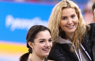 Evgeniya Medvedeva (left), Eteri Tutberidze