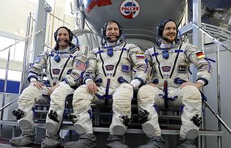 NASA astronaut Serena Aunon, Russian cosmonaut Sergei Prokopyev and representative of the European Space Agency Alexander Gerst