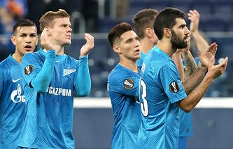 FC Zenit St Petersburg's Alexander Kokorin (2nd L) and Luis Neto (R) celebrate winning their 2018/19 UEFA Europa League Group C Round 2 football match against FC Slavia Praha at Saint Petersburg Stadium.