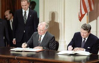 General Secretary of the Central Committee of the Communist Party of the USSR Mikhail Gorbachev and President of the United States Ronald Reagan (L-R) signing the Treaty between the United States of America and the Union of Soviet Socialist Republics on the elimination of their intermediate-range and shorter-range missiles (INF Treaty) at the White House in 1987